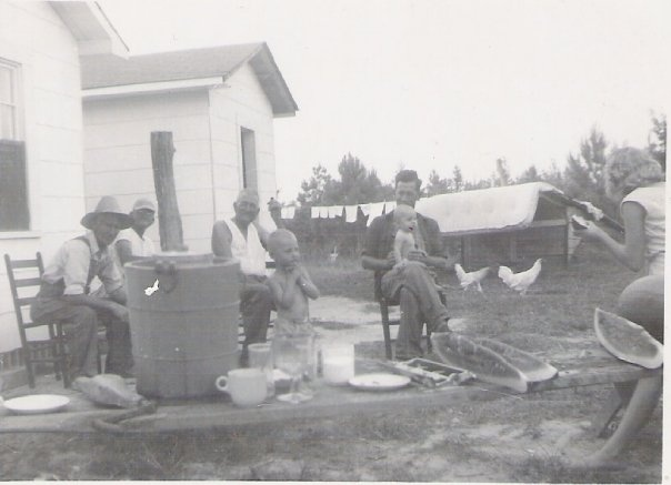 chickens, watermelon, laundry on the line, indoor-outdoor chairs.....Mississippi long ago...