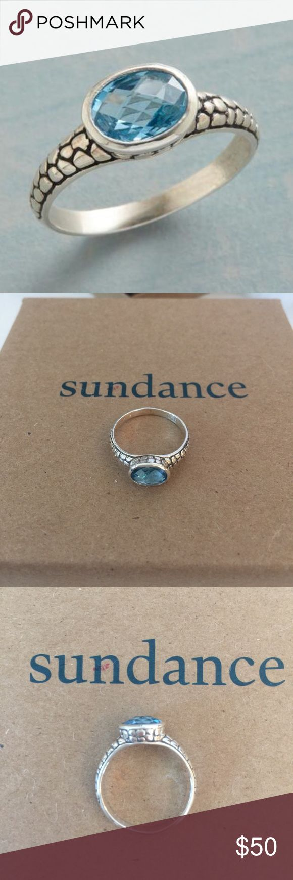 NWT Sundance Size 6.5 Brazilia Ring. NWT- Size 6.5 Brazilia Ring from Sundance Catalog. Silver, hand cast with a pebbled pattern, holds a blue topaz faceted to bring out its brilliance. Exclusive. Sundance  Jewelry Rings
