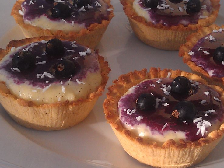 Coconut and blackcurrant tartlets
