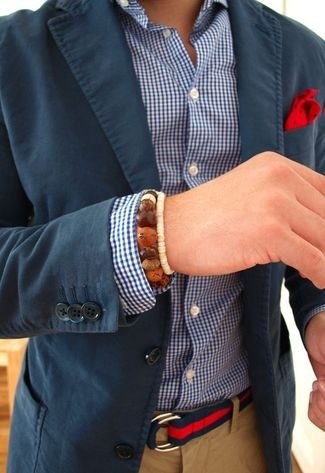 Men's Red Polka Dot Pocket Square, White and Navy Gingham Longsleeve Shirt, Navy Blazer, Khaki Chinos, and Red and Navy Horizontal Striped Canvas Belt