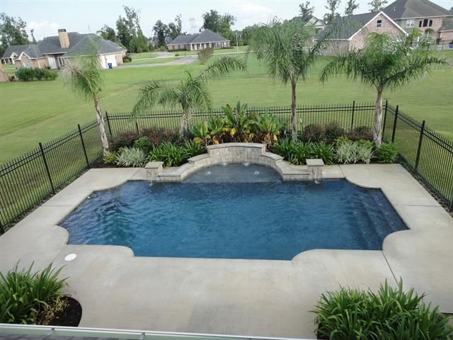 Love the black fence around the pool outside landscape for Landscaping ideas for pool areas