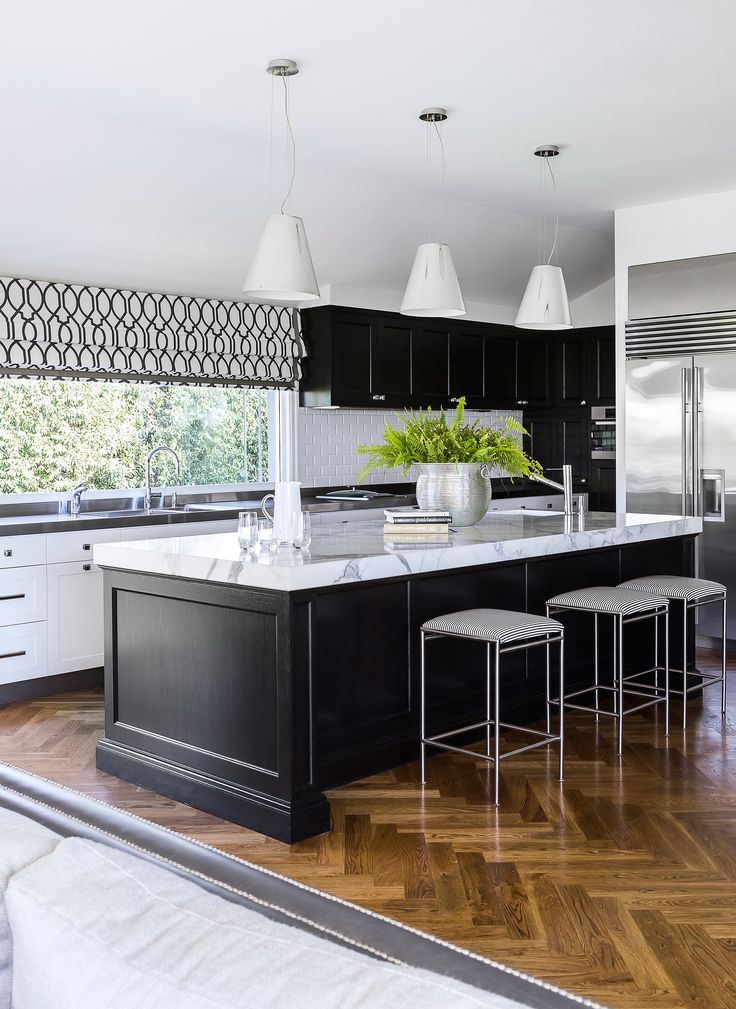 The refurbished kitchen of this Colonial-style Queenslander, with Carrara marble and stainless steel benchtops, has plenty of storage and prep space. Photography: Maree Homer | Stylist: Kate Nixon