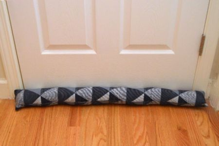 Stopping a draft with homemade door draft stoppers is one of the easiest ways to create an energy efficient home.