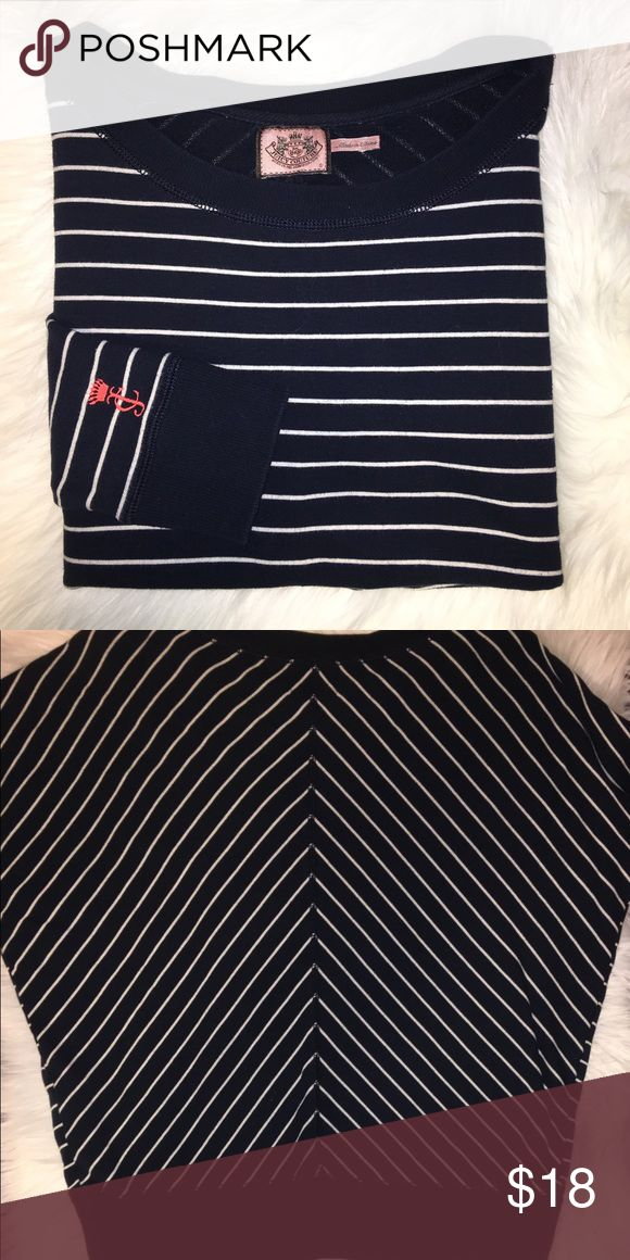 """🎀Juicy Couture Nautical Sweatshirt📣 🎀Slouchy, nautical Juicy couture sweater 🎀navy blue/white stripes with pink """"JC"""" logo on left sleeve 🎀Excellent pre loved condition 🎀3/4 sleeve length ⚠️25"""" bust. 19"""" across bottom. 22"""" from collar to hem. 16"""" from pit to hem. 10"""" sleeve.  📣From a smoke free, pet free home. No rips, stains, or tears. 📣Next day shipping from CA 🥑 if ordered by 3pm (EXCLUDING weekends and holidays)  🛁Recently laundered in All Free &Clear🛁🚫Trades 🚫Off Posh…"""