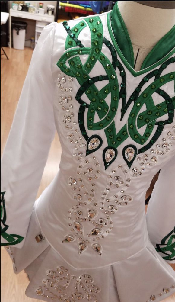 For sale approx size: g14 Beautiful New white and green dress with clear and green crystals. White sparkle satin. Kelly Green lining. Comes with green span [Prime Dress Designs, Irish Dance Dresses, Irish Dance Dress, Solo Dress]