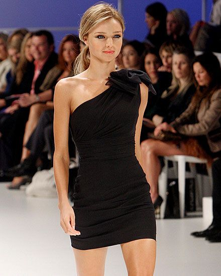 Miranda looks stunning in this off the shoulder fitted black dress