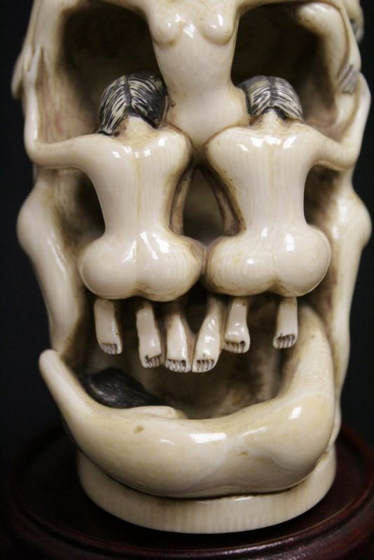 "Japanese ivory carved okimono depicting skull motif with nude, 3.6""H"