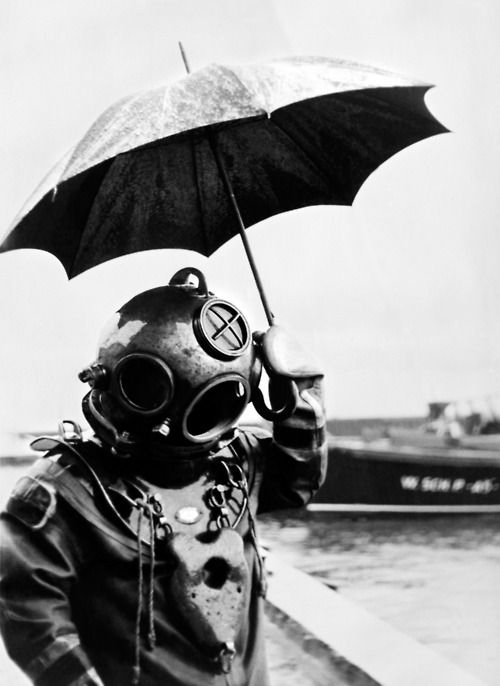 Scuba diver with an umbrella. Paris, 1949.    In 1943, Captain Jacques-Yves Cousteau invents, with Emile Gagnan, the first commercially successful open circuit type of Scuba diving equipment, the aqualung.