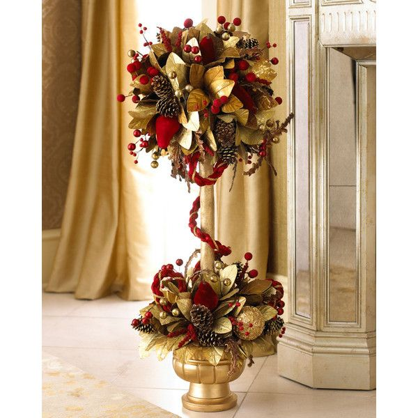 Handcrafted Christmas topiary makes an elegant statement with its combination of intricately carved balls, pinecones, red velvet pears, and velvet cord mounted...