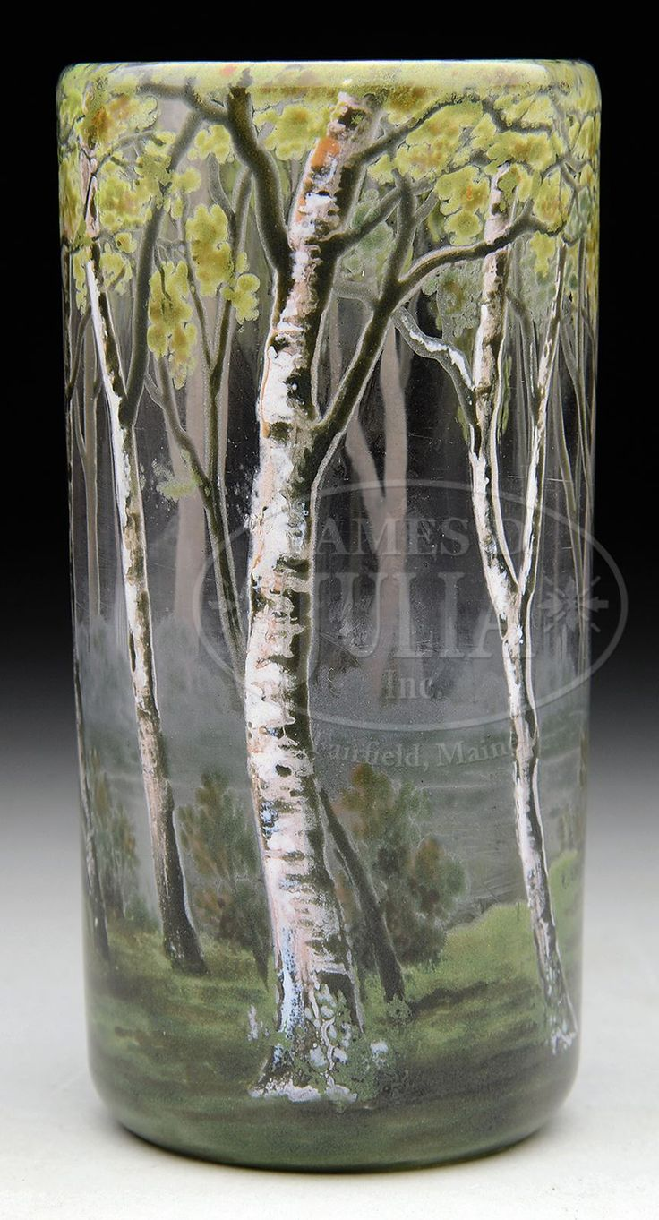 "DAUM ENAMELED BIRCHES TUMBLER/VASE. Daum vase is beautifully enameled with birch trees rising from green grass ground with pond and forests in distance. All against clear glass background. Signed on underside with gilded etched mark ""Daum Nancy"" with cross of Lorraine."