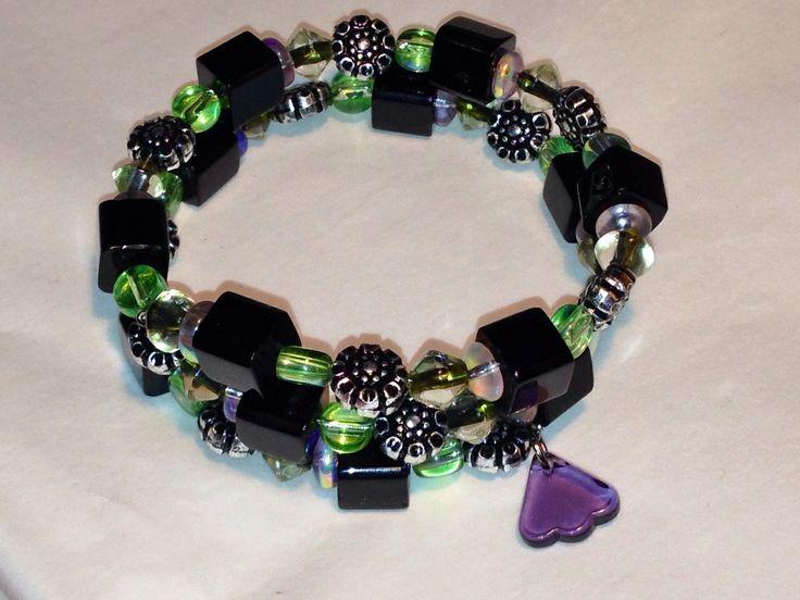 Jewelled Designs - Black bead and flowers wrap bracelet, $20.00 (http://jewelled-designs.mybigcommerce.com/black-bead-and-flowers-wrap-bracelet/)