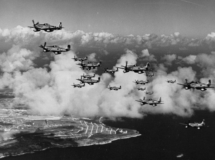 Colonel James Beckwith commander of the 15th Fighter Group in his P-51 Mustang Squirt leading P-51s of the 45th Fighter Squadron from their base on Saipan to their new base on Iwo Jima 7 March 1945.
