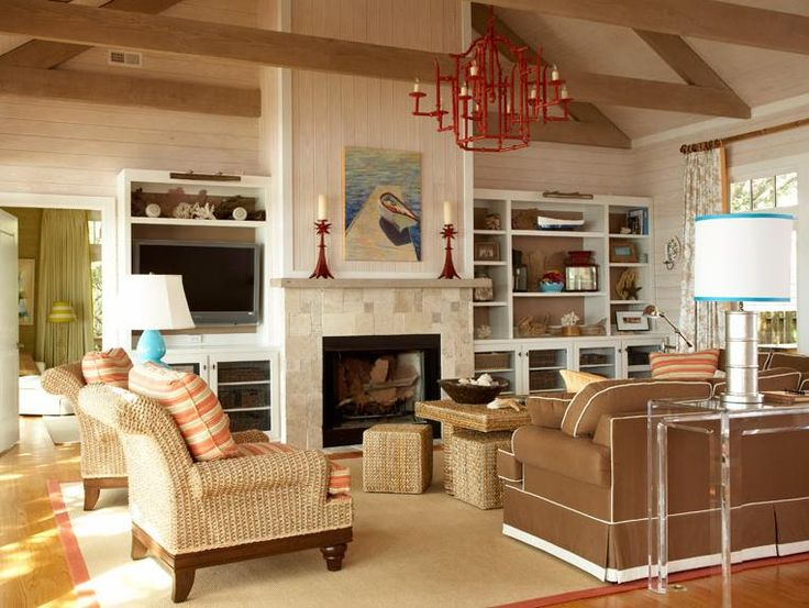 beige and coral living room with splashes of blue the beach theme is completed