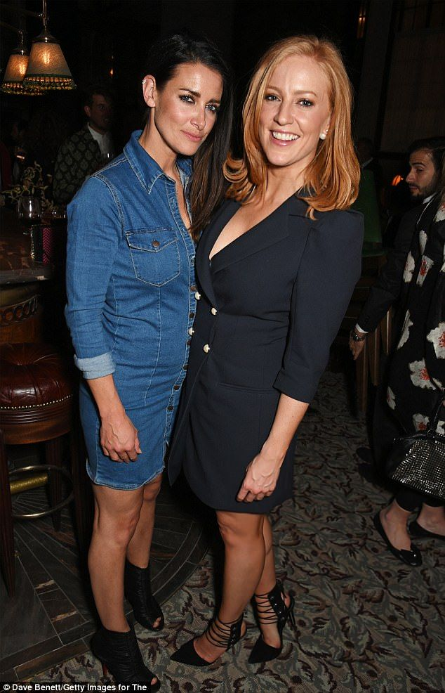 Denim dream: Kirsty Gallacher (left) cut a stylish figure in a fitted denim dress and leather peep-toe boots while posing alongsideSarah-Jane Mee (right)