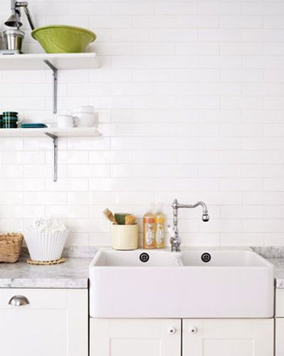 {This is glamourous} Belfast sink and white tiles looks so fresh.