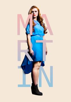 Lydia Martin played by Holland Roden. They used a lot of Holland's own wardrobe for her character :)