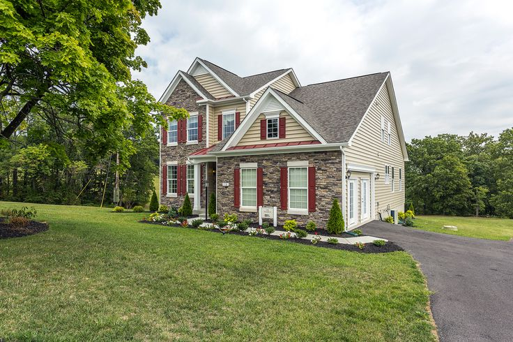 Beautiful Model Home With Stone Siding Red Shutters Red Door And