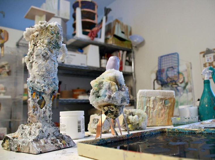"""This week's featured work in progress comes from Kuh Del Rosario (@kuhldays). """"Current works in progress of small scaled sculptures. Sculpture in the foreground is made from appropriated soccer trophy borax crystals found sea shells sand and pebbles shards of autoglass plaster acrylics latex colored inks. Smaller sculptures in the background are astroid pieces of various foam acrylic caulking acrylic latex borax crystals and other deconstructed things harvested from my immediate environment…"""