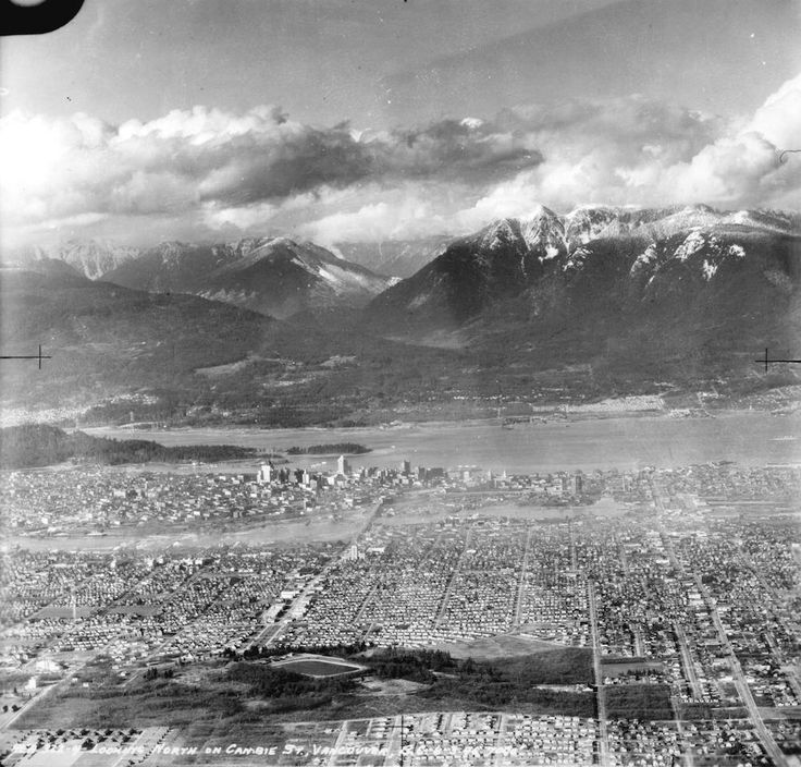 Aerial view of Vancouver looking north on Cambie St. Photograph shows Little Mountain Reservoir, Hillcrest Park, Queen Elizabeth Park, Riley Park and South Cambie neighbourhoods and False Creek. Mar. 6, 1946 (Photo via Vancouver Archives)