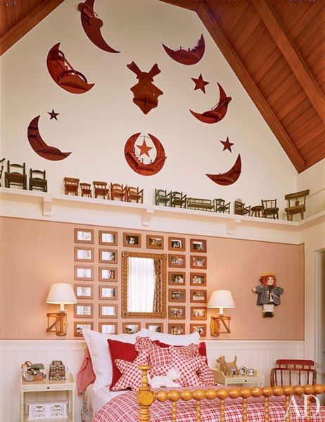 In an Aspen, Colorado, vacation house that combines classic lodge and Craftsman styles, Arthur Chabon created a girl's room that embodies the all-American spirit of both. On one wall, a collection of artful crescent moons, miniature wooden chairs, and framed family photos add a personal touch. (December 2007)