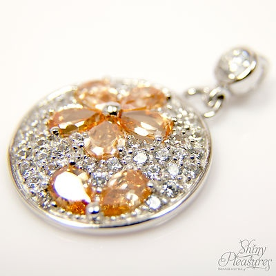 SPARKLY Orange and White Diamond Simulant Floral Design Sterling Silver Pendant. This is one of my favourite pieces. I found it hard to resist keeping it for myself! The tangerine petals are alluring and just so feminine. While it could be worn at any time, it has that sparkle for a special night out - $36.99 with FREE shipping.