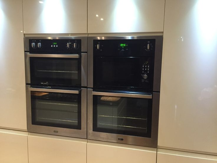 Craig's Stoves built-in double ovens in stainless steel - a gorgeous and roomy side-by-side pair in his sleek white modern kitchen.