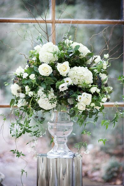Glass urn of winter whites, trailing jasmine, ivy and willow