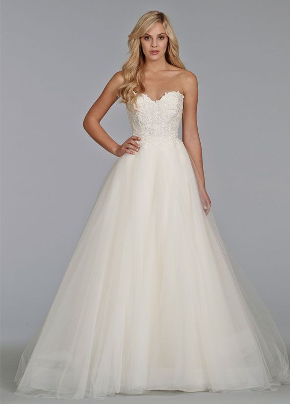 Ivory tulle bridal ball gown with Venice lace bodice, strapless sweetheart  neckline, full tulle skirt with chapel train.  Available by request  VIEW NEXT STYLE >