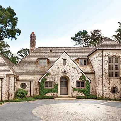 """Peter Block Country Style Makeover - Southern Living - Remake History When it comes to designing houses, architect Peter Block tries to avoid strict stylistic definitions. """"First we go for feel,"""" he says. """"Style finds its way."""" Case in point is the new home of Marcia and Mark Miller, located on a rare expansive lot in Atlanta's Buckhead area. For its design, Peter looked to the English Country houses of the late 19th and early 20th centuries."""