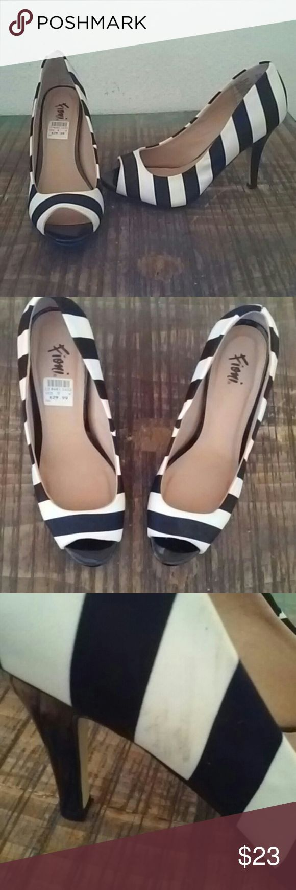 "*FIONI* Striped Heels Black and white stripe heels. Gently worn. I purchased these and they are too big. They are an 8W. Small mark on right side of right heel. Not noticeable and can be cleaned. no signs of wear in inner soles and bottoms show very little wear.  Heels measures at 3"" so super comfy!Worn 3times!!! Has original tags on heel. Accepting offers! FIONI  Shoes Heels"