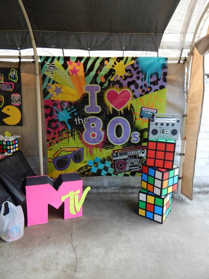 All 80's props made using Dollar Tree products and cardboard boxes. Used poster board and electrical tape for the cubes. Also used duct tape for the boom box.