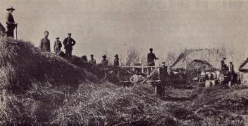 First Wave of Ukrainian Immigration to Canada, 1891-1914. Ukrainian settlers threshing, Stuartburn, MB, 1900.