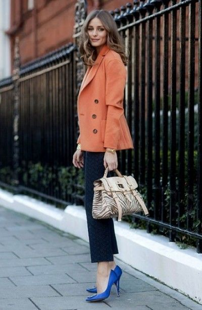 London Fashion Week 2012 - Olivia P. looks great with her pops of color and fun Mulberry bag. (Fashion Telegraph) via glitterguide