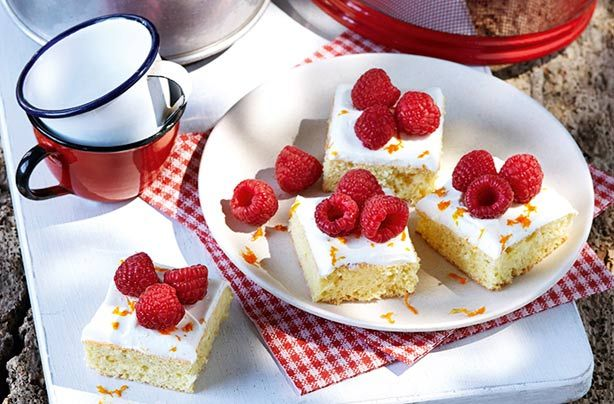 Slimming World's orange and raspberry bites are so simple to make, with a zesty base and using Quark to cheat the frosting and fresh fruit on top.