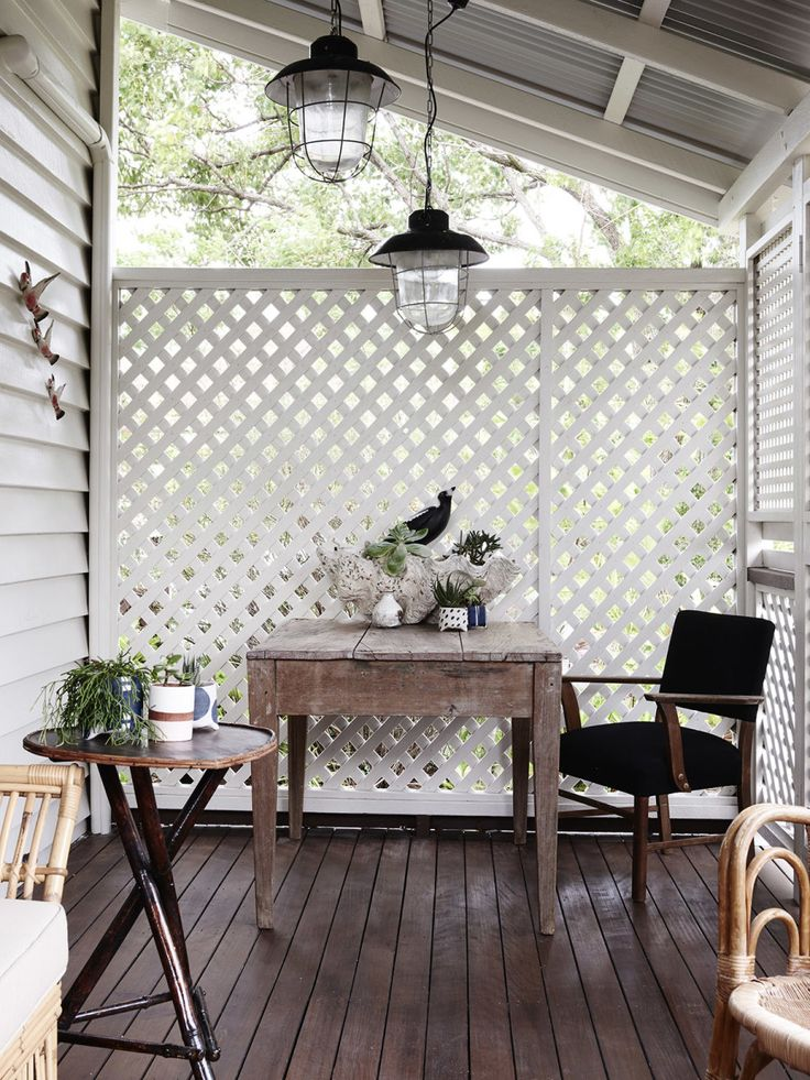 porch privacy screen and hanging lanterns