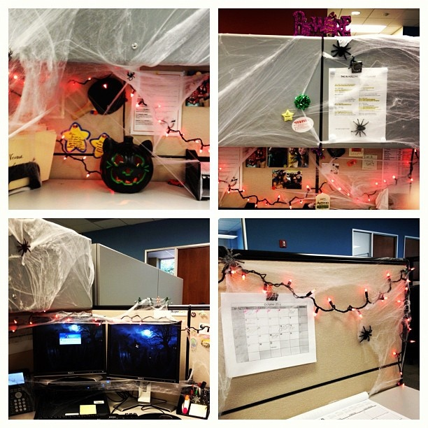 were getting into the spirit at the office let the halloween cubicle decorating
