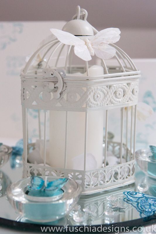 Buttery birdcage centre piece with accessories. www.fuschiadesigns.co.uk