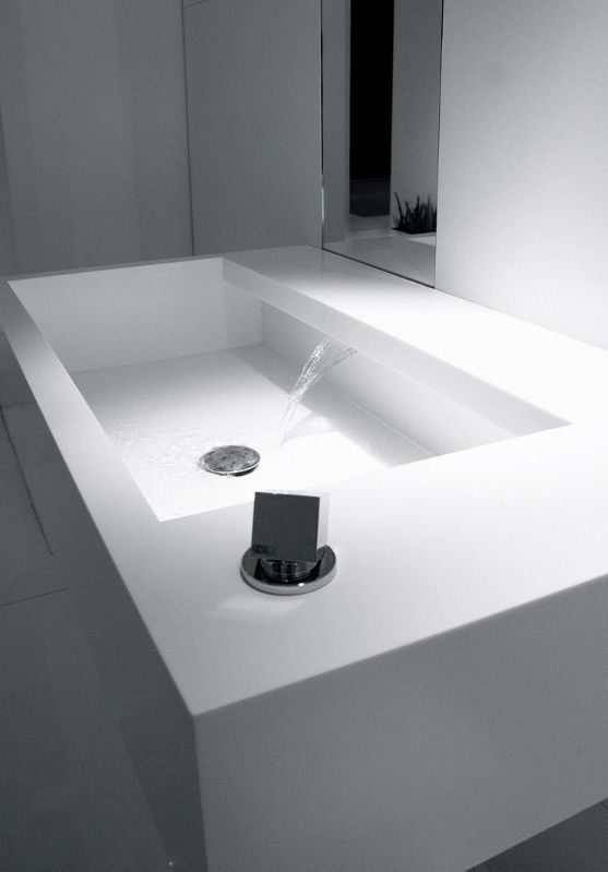 Fabrizio Milesi for Studio Moab | AIS Wall mount Corian® basin Can't get much more minimal in taps than that