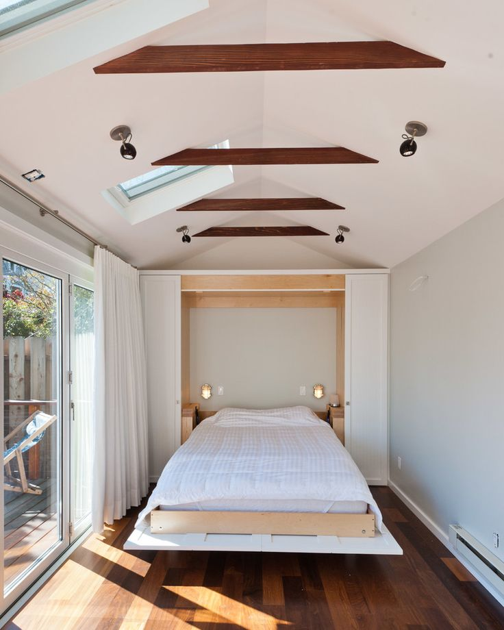 fold down bed bedroom with beams ceiling lighting deck