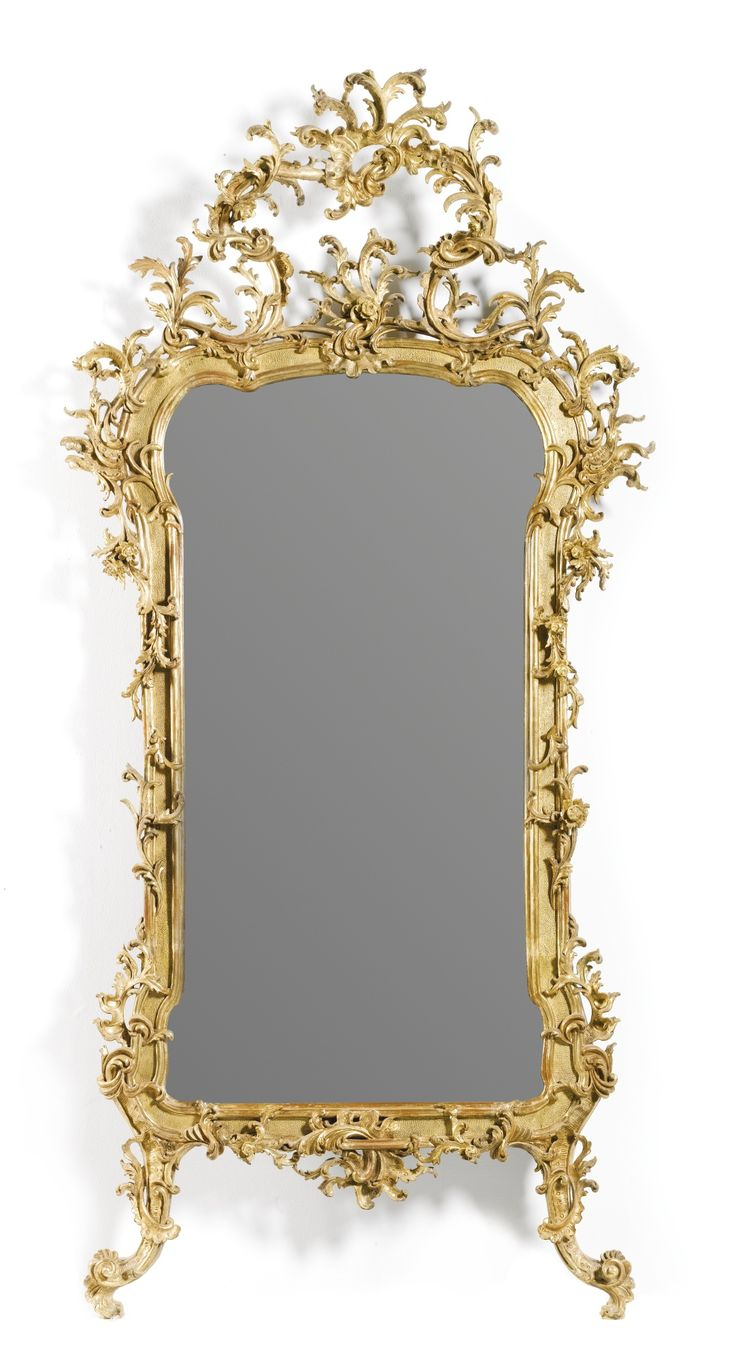 AN ITALIAN CARVED GILTWOOD MIRROR, POSSIBLY MILANESE, CIRCA 1750