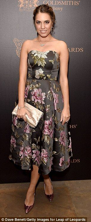 Bloomin' beautiful! The daughter of supermodel Yasmin Le Bon looked flawless in her strapless floral midi-length dress