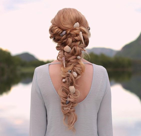 Shell-Embellished Braid - Best Beach Wedding Hairstyles: Tips and Ideas - EverAfterGuide