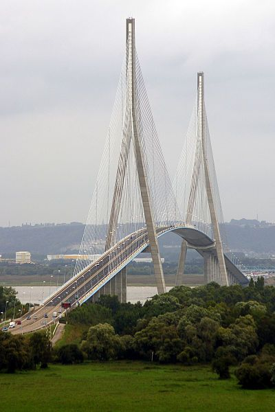 Pont de Normandie - april 2015 The Pont de Normandie is a cable-stayed road bridge that spans the river Seine linking Le Havre to Honfleur in Normandy, northern France. Its total length is 2,143.21 metres (7,032 ft) – 856 metres (2,808 ft) between the two piers - amazing drive across this bridge!