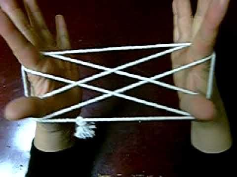 How to play cat's cradle string game by yourself. This game keeps girls busy at camp at night time when it's quiet time.  Just keep lots of yarn handy.