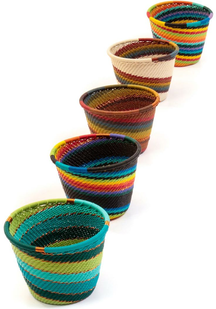 Zulu wire baskets are woven from a wire very similar to telephone wire. View our website for more information about these fascinating baskets. #FairTrade #BasketsofAfrica #Weaving