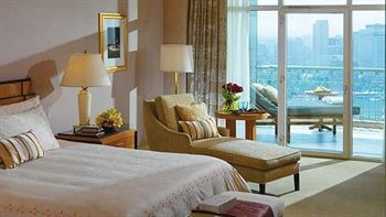Four Seasons Hotel Cairo Nile Plaza in Cairo, Egypt with floor to ceiling windows opening out to the nile