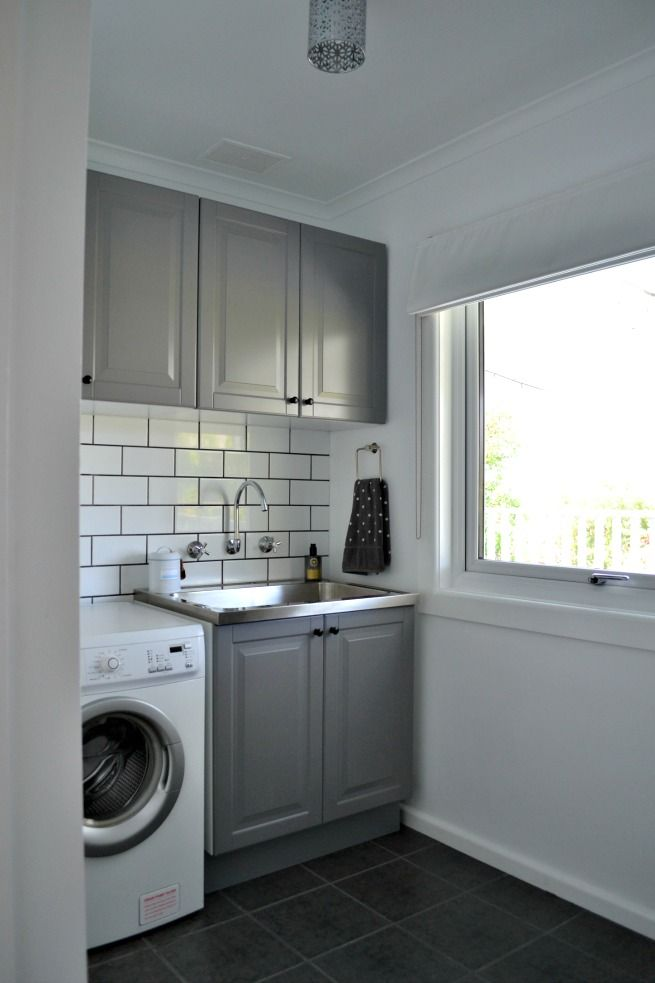 laundry room-subway tile + grey cabinets