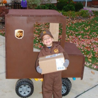 Power Wheels truck modified by my husband and brother to turn into a UPS truck.  Best costume EVER!!!!