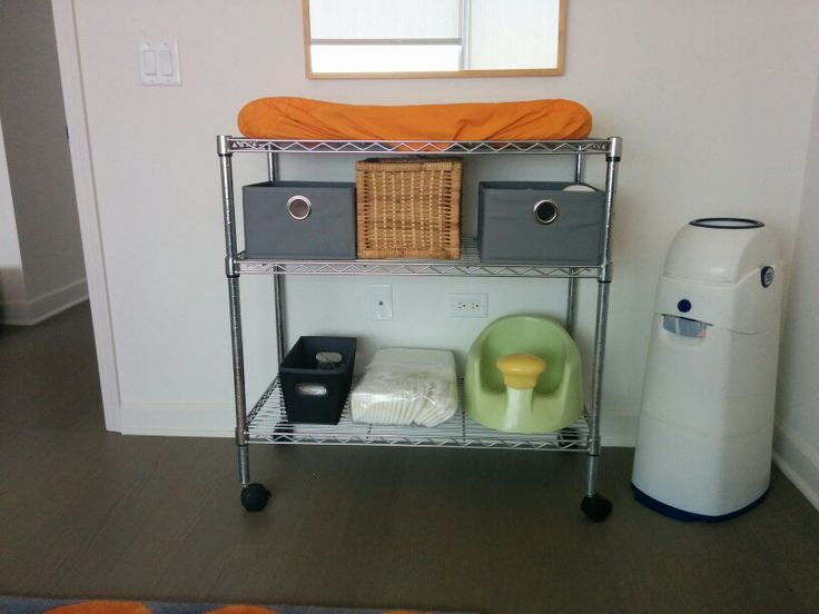Industrial changing table: Repurposed chrome shelf. (Dad's old DJ tables put to good use.)