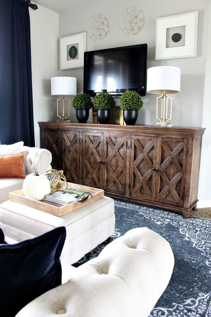 A Modern Family Room Loft Featuring Beautiful Burnt Orange Pillows Blue Wool Rug Brass